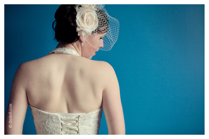 Bridal portrait of her birdcage veil
