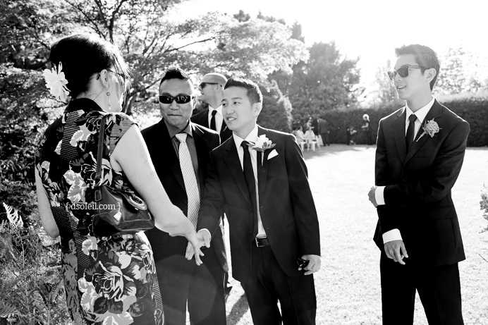 Groom greeting guests arriving for the wedding ceremony
