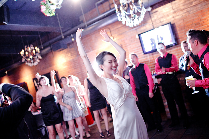 Bouquet toss at Brix wedding