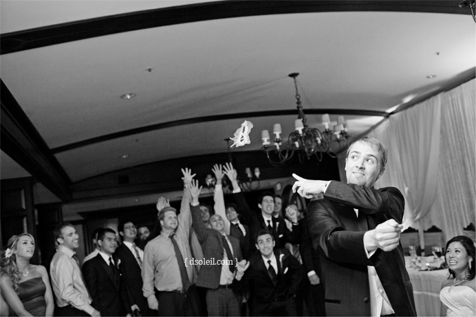 Garter toss at the Capliano Golf & Country Club wedding