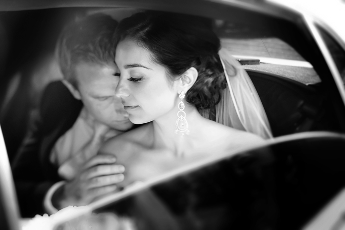 Bride and groom in limo at Fairmont Pac Rim Hotel Vancouver