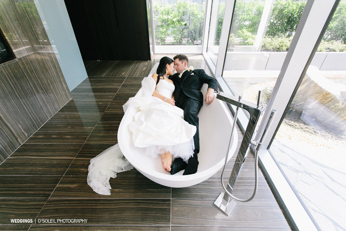 Wedding couple in bath tube at Fairmont Pacific Rim