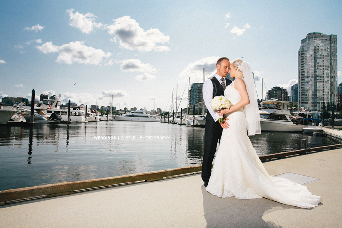 Bride and groom at False Creek sea wall Vancouver