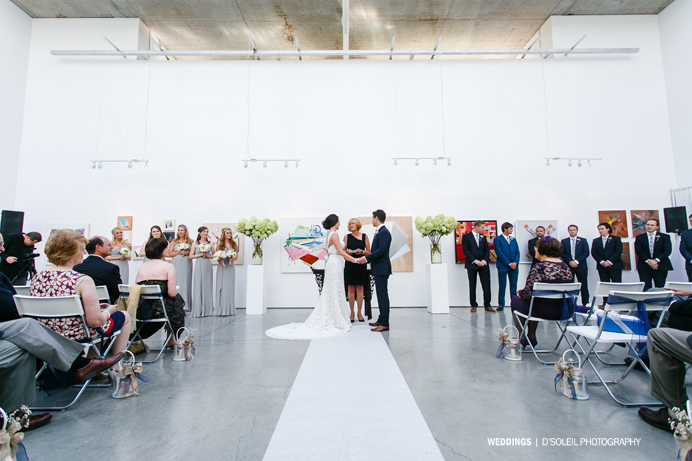 Waterfall Building wedding ceremony with bride walking down aisle