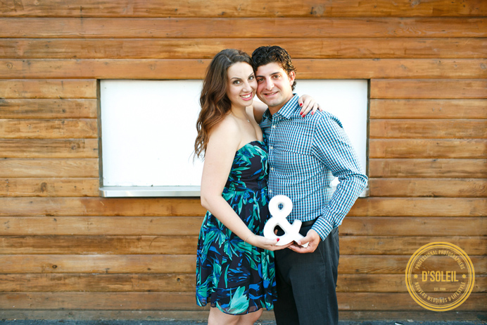 and ampersand sign engagement photo