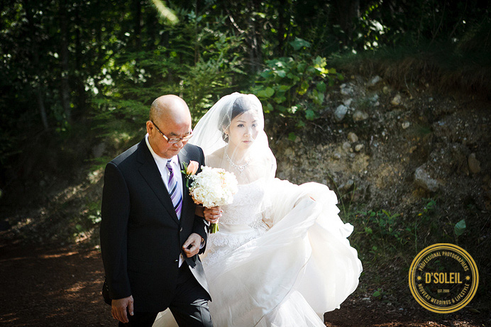 bride walks with dad