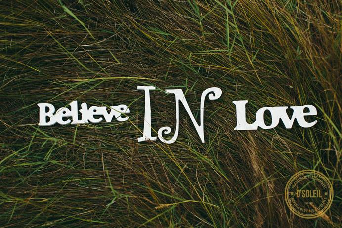 Believe in love sign in field