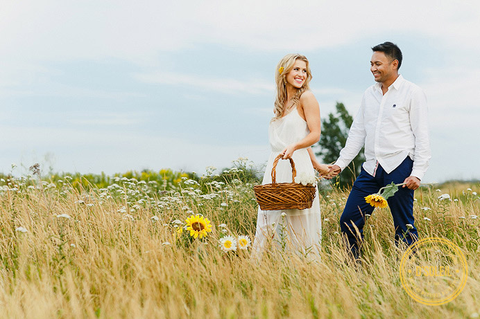 Field picking flowers engagement session