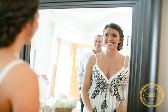 bride looking in mirror before wedding