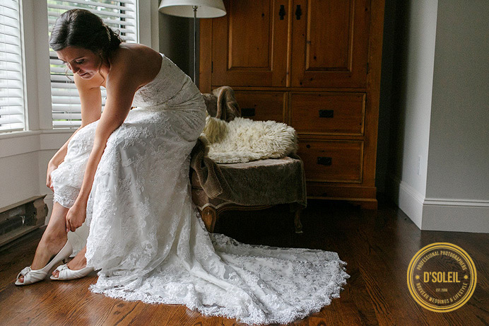 Bride getting putting on shoes