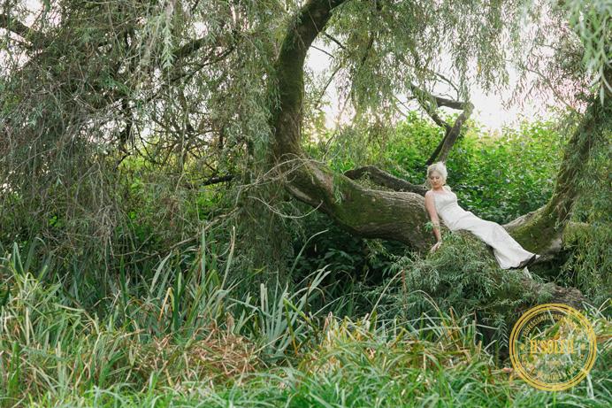Bride on tree wedding photo