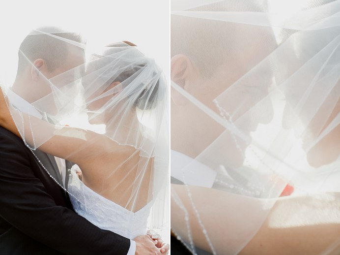 bride and groom under wedding veil