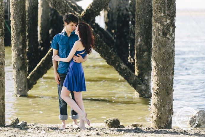 Under a pier wedding engagement