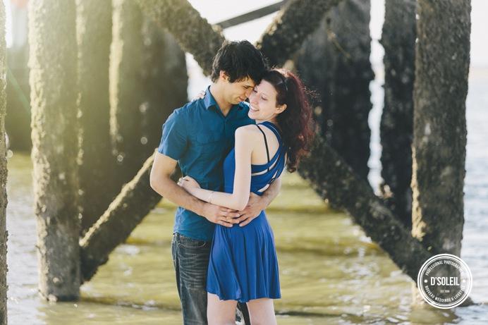 Under a pier wedding engagement