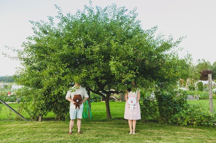 quirky engagement photo under tree