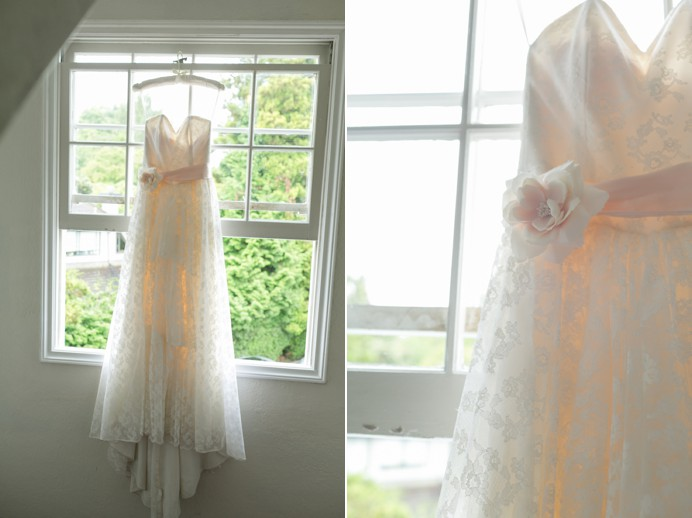 Wedding dress hanging over window