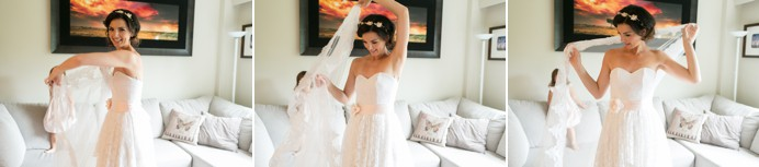 Bride puts on wedding veil