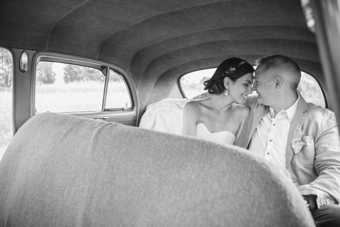 Bride and groom with vintage 1940 Mercury