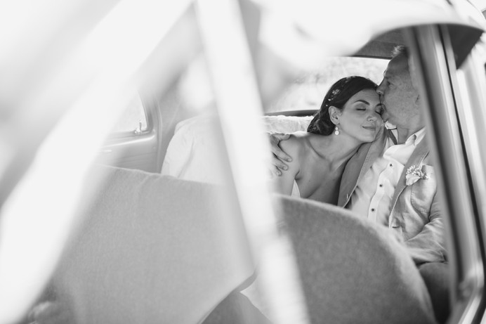 Vintage wedding photo in car