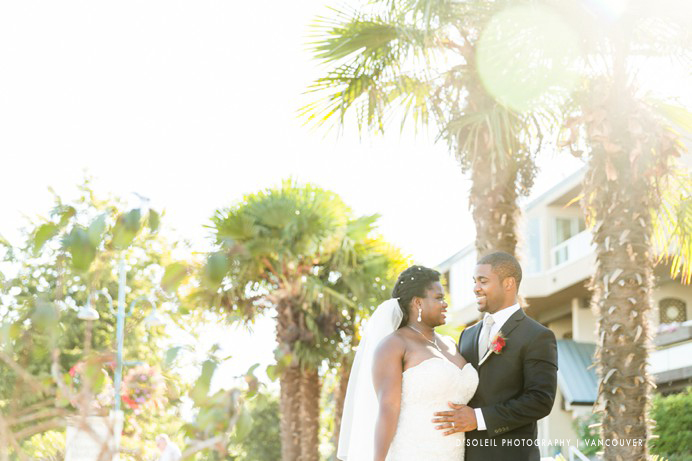 Bride and groom with palm trees at New West Quay
