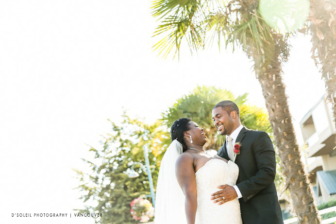 Bride and groom with palm trees new west quay