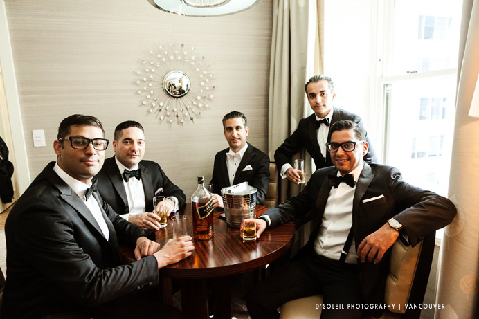 guys posing for wedding day photo at Hotel georgia