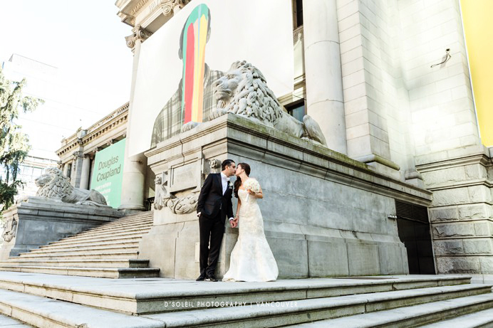 Bride and groom at Vancouver Art Gallery Lions