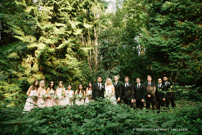 Wedding party in the woods surrounded by trees