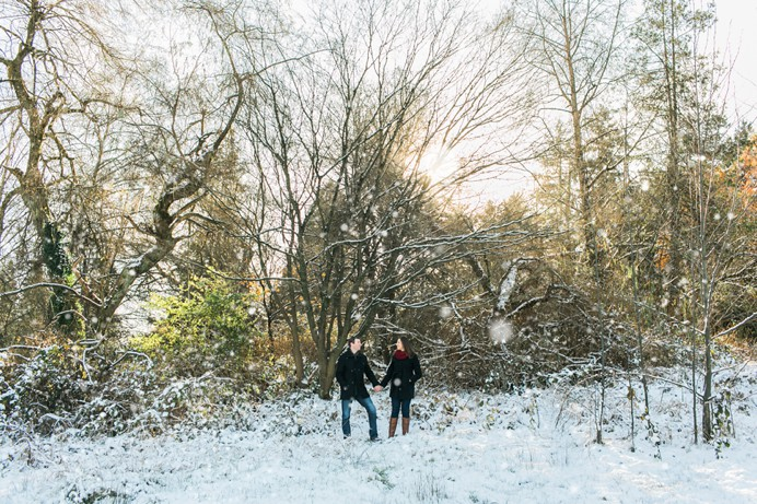 Snowy engagement photos in the woods