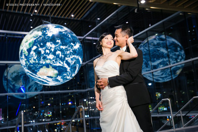 Earth globe with bride and groom at the Vancouver Convention Centre wedding photo