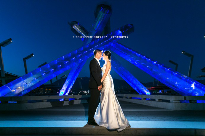 Wedding photo in front of Olympic Cauldron at Vancouver Convention Centre