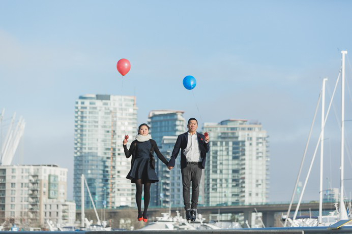 Jumping photo with balloons at False Creek Yaletown