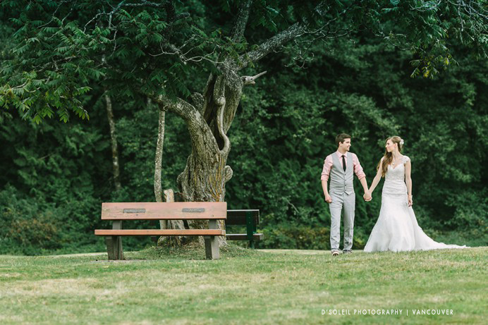 bride and groom under an old tree