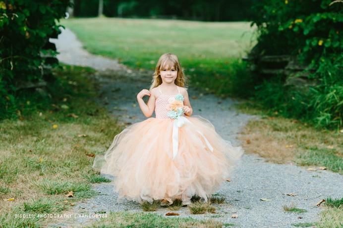 little flower girl in peach coloured dress