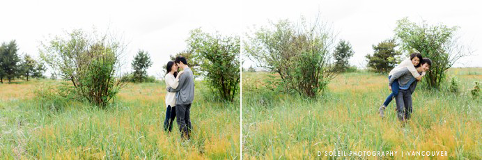 couple standing in a field of tall grass engagement photo