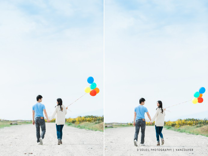 couple walking with balloons