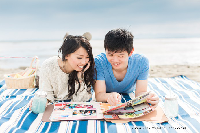 couple looking at scrapbook at engagement session