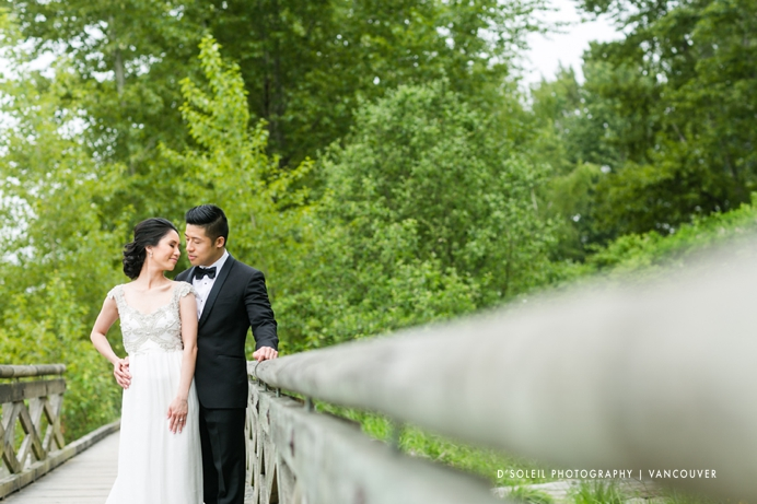 bride and groom at a nature park next to the Fraser River in Vancouver