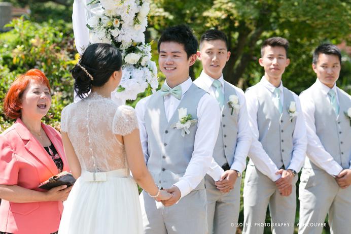 Grooms smiles at bride