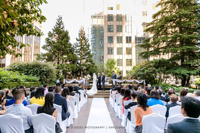 Four Seasons Hotel wedding ceremony outdoors on patio