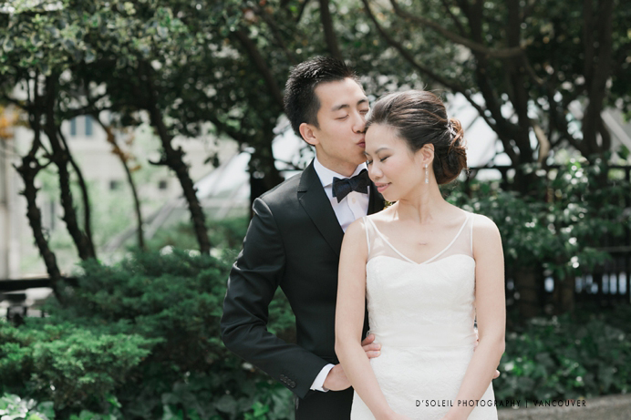 Groom kisses bride at Four Seasons Hotel Vancouver