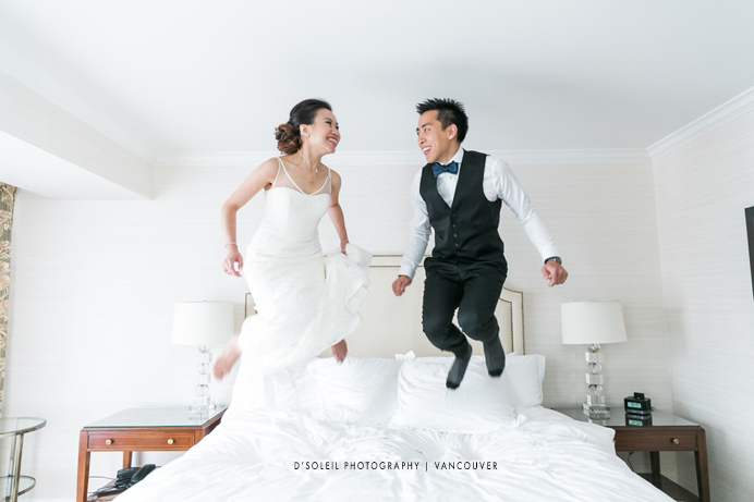 jumping on the bed wedding at Four Seasons Hotel Vancouver