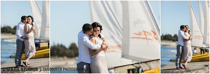 Engagement session with sailboats at the beach