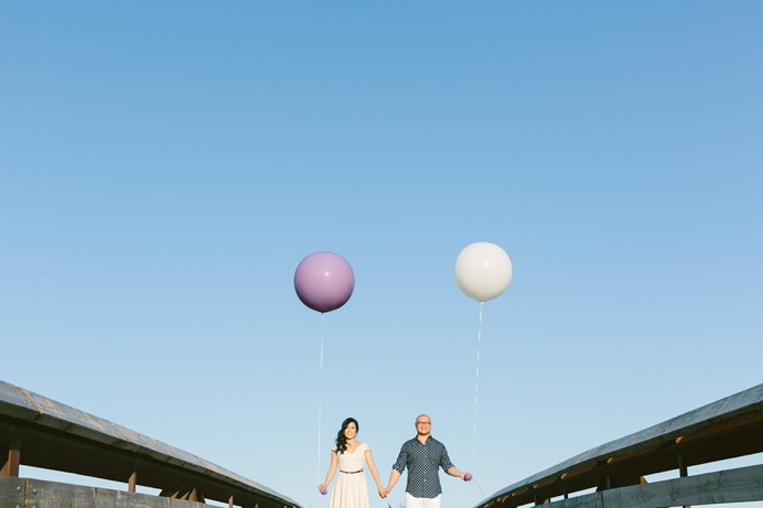 couple with round balloons at engagement session