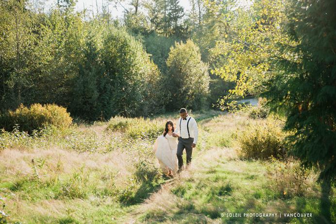Bride and groom walking in the meadow